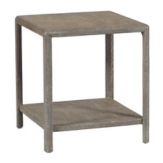 Materials: Shagreen/Wood  Finish: Grey Shagreen    This sleek yet simple faux shagreen table has a nice surface area and shelf. The natural shagreen color easily blends with any décor for those with an eclectic and sophisticated taste.