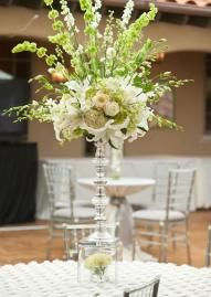 A gorgeous green and white floral arrangement from Hydrangea Floral atop a crystal candlestick gives an elegant feel!  Photo by Courtney Morehead Photography  #wedding #centerpiece #white #green #crystal