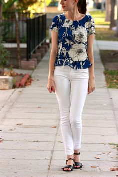 Floral blouse, white jeans, and black sandals