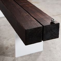 """Wood and steel combine in this striking industrial bench. Cedar treated to Japanese art of burning, called shou sugi ban, is carefully charred to create a beautiful protective natural finish. The .25"""" steel plate legs of the bench are painted white in beautiful contrast to the wood's dark beauty."""