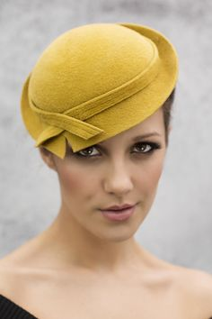 New Gold by Maggie Mowbray. #millinery #judithm #hats Love the simplicity. Still fetching.