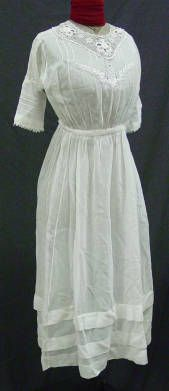 1900-1909   Dress - white cotton lawn one piece graduation dress. Bodice is gathered all the way around, with gathers concentrated in front. Crocheted lace inset around neckline, with eyelet embroidery beneath and across bust, pin tucks from shoulder.  Brigham Young University Collection