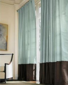 thinking of making curtains with a contrast bottom panel for all the windows in our living room and dining room...