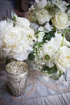Love it all....the peonies, mercury glass and the linens!