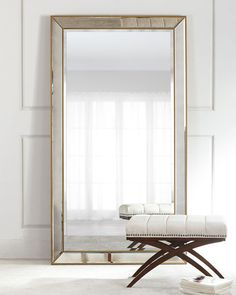 """#ONLYATNM Only Here. Only Ours. Exclusively for You. Mirror-framed mirror. Wood composite backing. Antiqued mirror trim. Golden finish on beading. Anti-tipping kit included. 43""""W x 79""""T. Imported. Wei"""