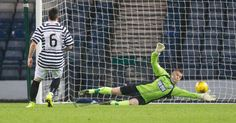 Queen's Park's keeper Wullie Muir makes a save during the SPFL League One play off game between Queen's Park and Cowdenbeath.