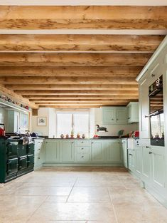 Mint green kitchen with British Racing Green Aga.