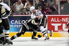 02.15.14 - Hershey Bears Captain, Dane Byers, releasing some anger on the WBS Penguins.  Photo courtesy of JustSports Photography.
