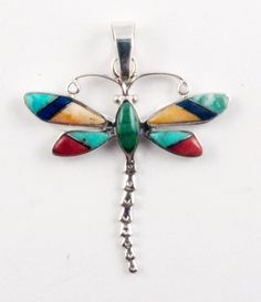 """Signed """"TS"""", Ted Secatero , Navajo, this pendant is inlaid with turquoise, lapis, & shell . #dragonfly $54"""