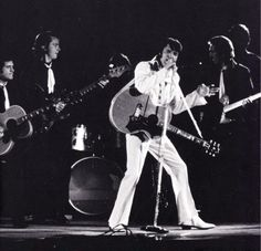 Elvis in concert at the Houston Astrodome in march 1  1970.