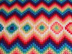 beautiful colorful #crochet blanket with granny squares and chevrons via German blog My World of Crochet