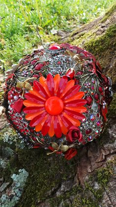 Gorgeous handmade brooch bouquet in red, with a dramatic feature vintage enamel brooch
