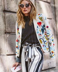 Olivia Palermo - This print-mixing pro shows us how it's done, playing with stripes, florals and the like—all in one look. Consider using black and white tones to ground your look and then pile brights on as a last layer.
