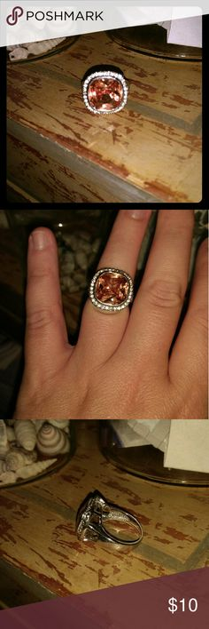 Costume dinner ring. Stone is champagne color Ring is silver with some wear see pics. Size is 8. Jewelry Rings