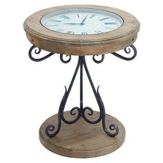 Showcasing a clock-inspired top and scrolling iron base, this eye-catching end table brings traditional appeal to your living room or master suite.