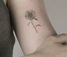 Dainty sunflower tattoo
