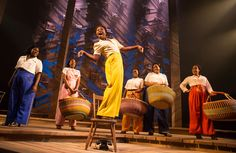 Cynthia Erivo as Celie and the cast of The Color Purple.