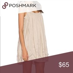 Coming Free People Dress Free People excellent condition raw linen blend Tunic dress with embroidery details . Worn once maybe and dry cleaned . Ties at the shoulder so it can be adjusted . Very loose style and will fit a size large generously . Free People Dresses