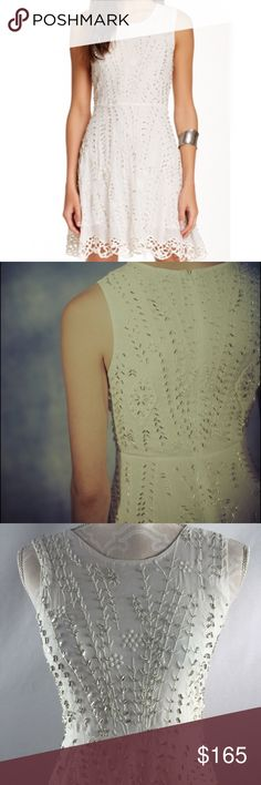 """Free People Sparkling Beauty beaded dress Gorgeous all over floral embroidery sparkled with glass beading. Fit and flare fit - stunning off white dress! Fully lined. 15"""" pit-pit, 13.5"""" waist and 34"""" long. Scalloped lace hem. 100% viscose. Tons of beading - new with tags but it is possible there may be beads missing - can't tell for sure though cause there are so many - truly an amazing dress (also comes with extra beads). Retail $300 Free People Dresses"""