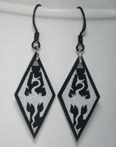 Skyrim Dragonborn Earrings--WANT!!  ^^^Okay, these are NOT Skyrim Dragonborn earrings. This is the symbol of Akatosh, one of the Aedra (The Nine Divines), and is the symbol of the Empire. Just because it's on Skyrim doesn't make it's Skryim's symbol. >:(  Sorry, nerd rant done.