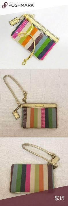 "Coach Poppy legacy sequin stripe wristlet!! Beautiful ""Poppy"" wristlet from Coach!! Legacy stripe print, with sequin details and a wrist strap. The wristlet has a zip top closure, a small Coach tag, and a green satin interior. One side of the wrist strap is detachable, if you prefer to tuck inside and use it as a clutch. In good, gently loved condition! The Coach Poppy logo on the front does have a small scratch, as noted in the 5th picture. There is also a mark on the back of the wristlet…"