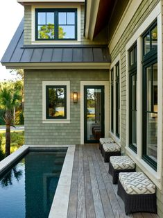 the back deck, elevated 10 feet above ground level, offers space to entertain guests, swim and enjoy the marsh scenery