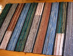 Woven rag rug~I like the blocks of color within the stripes.  Also, the black stripes dividing the larger areas.
