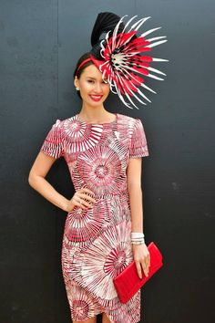 Chloe Moo from Sydney won the Fashions on Field at the Melbourne Cup 2013 in a Raw Cloth black, red and white hand printed dress, Valentino Shoes and Monsoon Millinery created by Melissa Cabot.