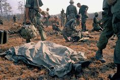 In this April 2, 1967 photo, a dead U.S. soldier lays on the battlefield with a sheet over him in Vietnam.