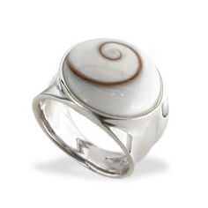 Sterling silver round Shiva Eye* Shell ring.    *The Shiva Eye shell (from the shell of a sea snail) is revered for the eye-like spiral pattern and is believed to have protective qualities. It also symbolizes development and motion, and is said to have a universally positive effect on well-being.
