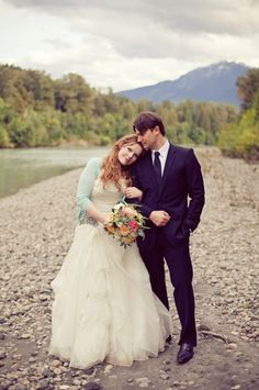 Her dress is so pretty with the rhinestone beading on the hip!  And I love the cardigan ...