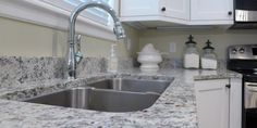 Accent Countertops specializes in kitchen and bathroom remodels. Check out our previous work and get design inspiration. White Kitchen Backsplash, Kitchen Countertop Materials, Granite Kitchen, White Counters, Granite Countertops Colors, Granite Colors, Elegant Kitchens, Beautiful Kitchens, Kitchen And Bath Remodeling