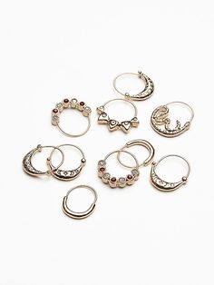 Stone Detail Hair Rings   Pack of 10 easy-to-use etched silver tone hair rings with stone accents.  Simple wrap these little rings through your locks to create an edgy look for your do.      *By Free People