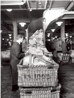 +~+~ Vintage Photograph ~+~+   Postman working package conveyor belt.  Mount Pleasant Post Office 1934