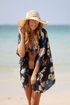 Nothing says lightweight like a breezy kimono on the beach. Use it as a chic swimsuit coverup. #beachstyle #kimono