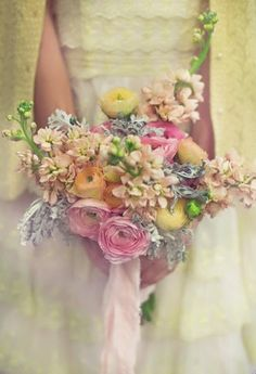 Amazing pink, yellow, blue, and green natural pastel bouquet for bride or bridesmaids at spring or summer wedding