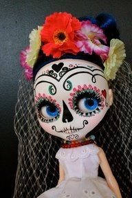 Sugar skull doll. I don't know if this would be pretty or too creepy for a little girl??