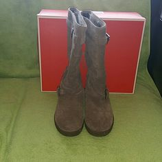 Coach Winter Walker, worn one time just like new Coach Thelma Boots - Embossed signature Cs on shimmering suede lend these plush winter boots classic style. Belting details and custom roller buckles add style and shine, while a substantial rubber so ... Coach Shoes Winter & Rain Boots
