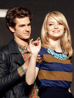 SEOUL MATES    Andrew Garfield can't help but show his affection for girlfriend Emma Stone at a press conference in Seoul, Korea, where the canoodling costars promoted their film The Amazing Spider-Man (out July 3) on Thursday.