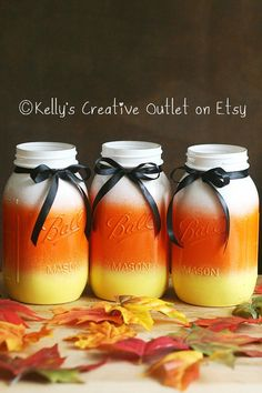 If scary Halloween decor isn't your thing opt for a more kid-friendly approach with this candy corn-colored trio of Mason jars. If scary Halloween d Diy Halloween, Halloween Mason Jars, Adornos Halloween, Easy Halloween Decorations, Happy Halloween, Halloween Candy, Halloween Bedroom, Halloween Weddings, Halloween Designs