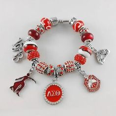 Red Bead Delta Sigma Theta Sorority Founder Lady 1913 Charm Bracelet BGLODeep discounts on over 300 products that enhance your life from day to day! Items for men and women of all ages, also teenagers. Take a look at our Hand Jewelry, Jewelry Gifts, Jewelry Accessories, Geek Jewelry, Beaded Jewelry, Jewellery, Strand Bracelet, Bracelet Sizes, Delta Sigma Theta Gifts