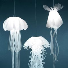That would be so cool for a children's room: Hanging Lamps That Look Like Jellyfish made of laser-cut mylar. Created by California-based designer Roxy Russell