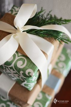 I like the burlap ribbon under the grosgrain ribbon. And sprigs of greenery...a nice touch.