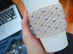 This simple cozy is knit using the beautiful 'daisy' stitch. The cozy is made to fit most medium size coffee cups perfectly. You can reduce waste by using this reusable sleeve instead of double cupping or using a disposable paper sleeve.