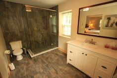 The Superior Suite boasts a stunning ensuite that has an oversized rainfall shower and infloor heat. Rainfall Shower, Glamping, Mirror, Outdoor, Furniture, Home Decor, Outdoors, Homemade Home Decor, Go Glamping