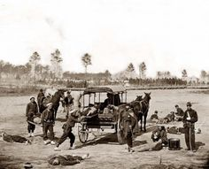 This is a picture of a Civil War ambulance crew. As you can see, Wagons were used to transport wounded soldiers.