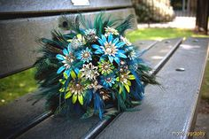 Use Peacock and Rooster Tail Feathers and add a splash of Aqua to your wedding day decor!