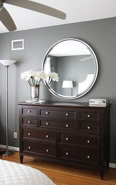 Grey Bedroom Walls. White trim. Dark furniture. pops of color throughout the room.