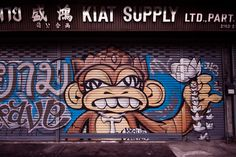 A monkey and his lotus flower.  Part of the #artwork that @kraveart put up on his wife's fam's hardware store in #Bangkok, which happened to be right next to my workplace. I shot this with my DSLR. #krave #monkey #lotus #streetart #graff #graffiti #elmonofresco #mia #bkk