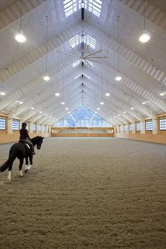 We are all envious of this rider riding in the indoor arena at the Riverlands Equestrian Facility designed by GH2 Equine Architects in British Columbia. Photo credit to: Ivan Hunter Photography